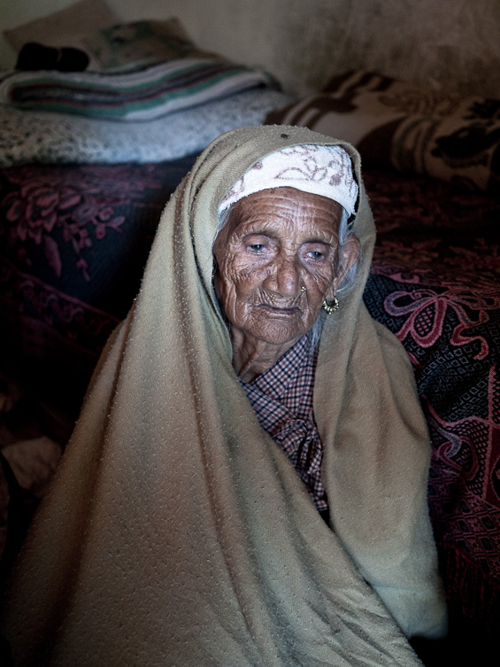 90 year old Nepalese grandmother in her room.