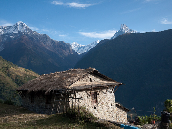 A barn on the Nepalese mountainside with Annapurna in the background.