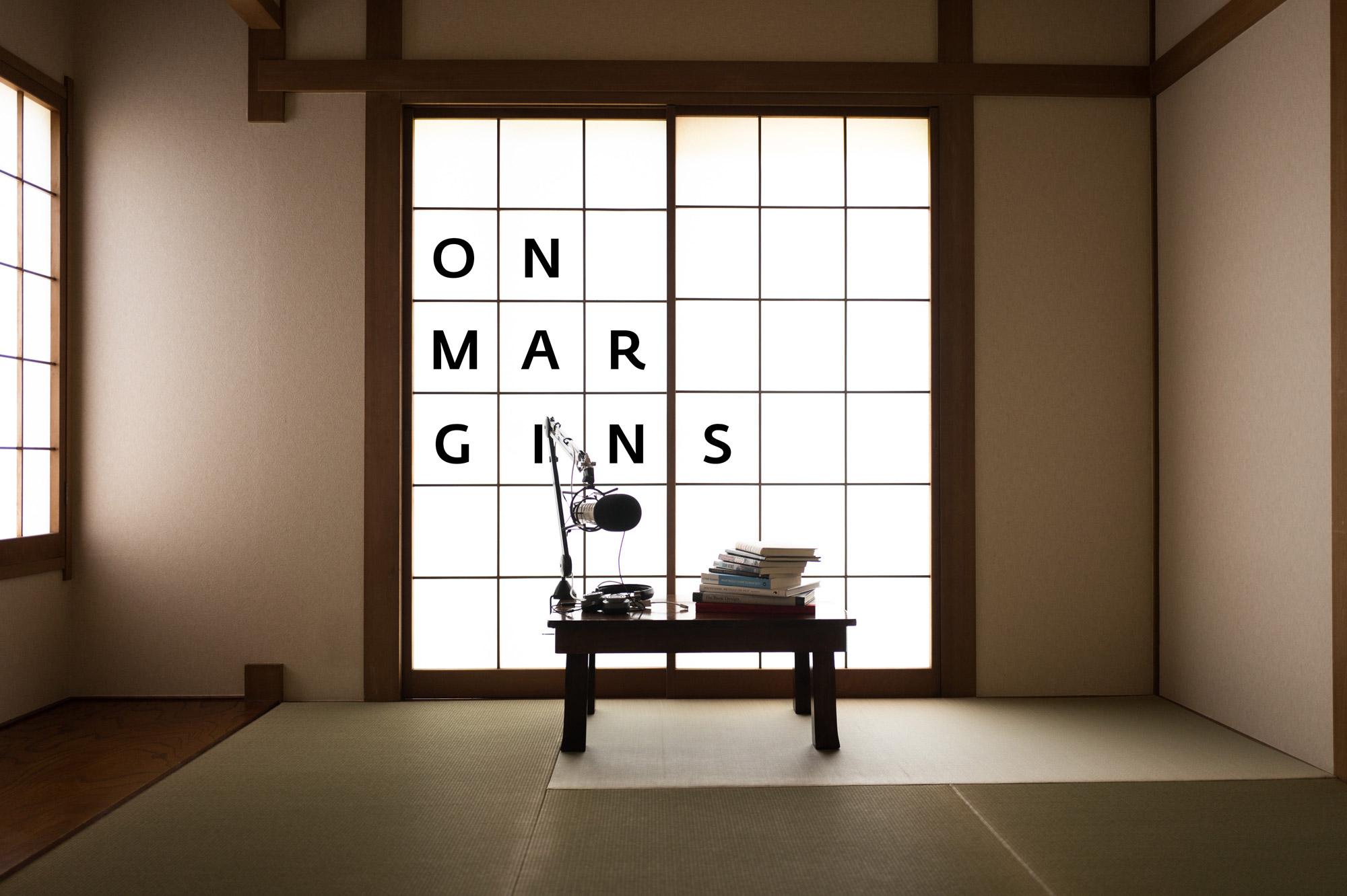 A Japanese room, tatami, shoji, a chbudai, a microphone, a stack of books
