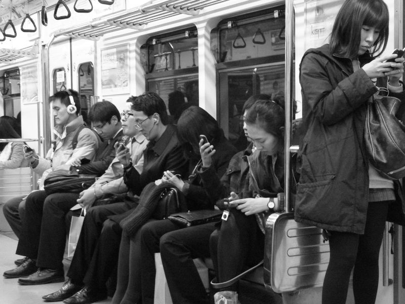 staring at smartphones on a train